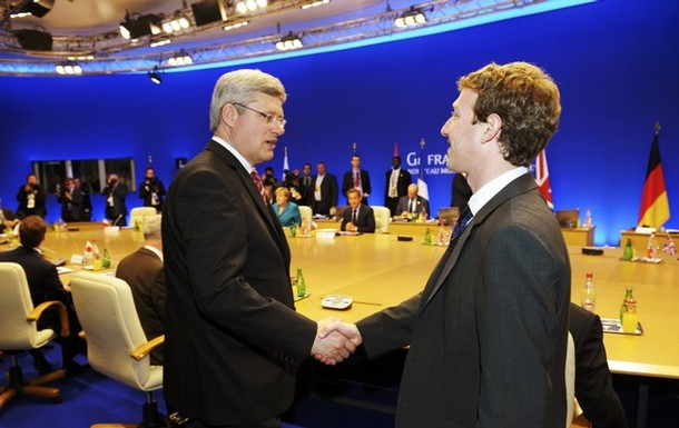 Facebook CEO Zuckerberg shakes hands with Canada's PM Harper at G8 Summit in Deauville